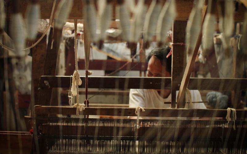 Man working at weaving loom