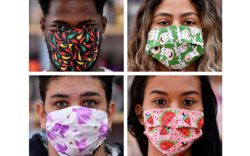 People wearing face patterned fabric coverings