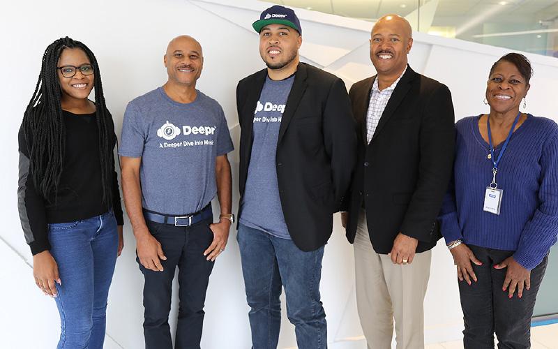 Sheoyki Jones standing alongside founders of Deepr