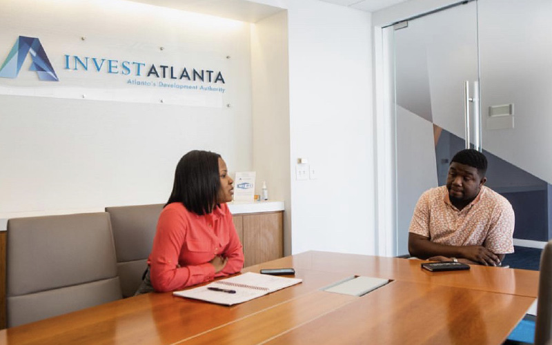 Sheoyki Jones meeting with a business founder in meeting room