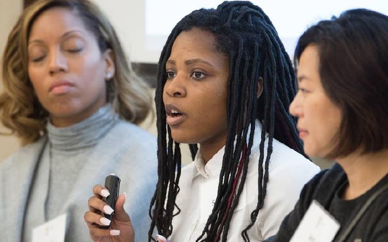 Sheoyki Jones speaking on a panel